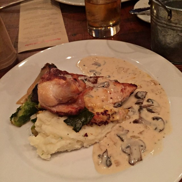 chicken breast | infused with smoked gouda pimento cheese served on buttermilk mashed potatoes with sherry-crimini mushroom sauce and brussel sprouts.